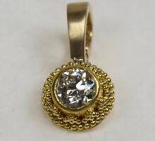 22 karat granulation on enhancer with diamond