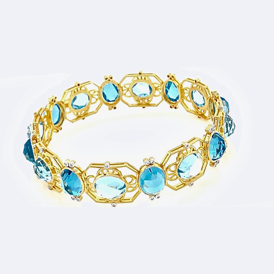 Bangle bracelet 14 k gild with blue topaz and diamonds available with amethyst